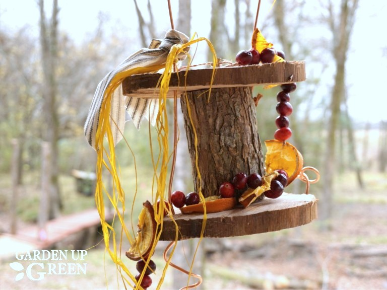 Wood slice and branch rustic bird feeder by Garden Up Green, featured on Funky Junk Interiors