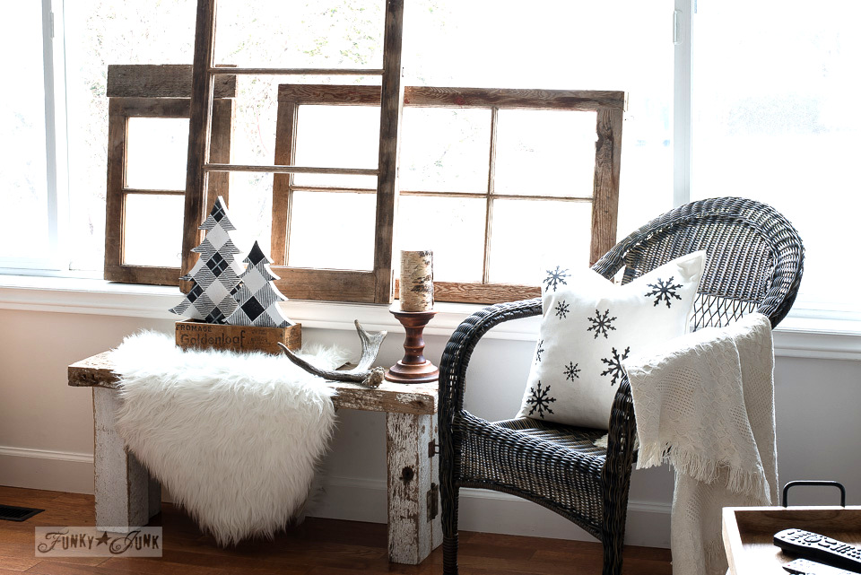 Wooden vintage windows, buffalo checked winter trees and a snowflake pillow in a winter living room. Part of Rustic winter decorating with black, white and wood. Full tour on funkyjunkinteriors.net
