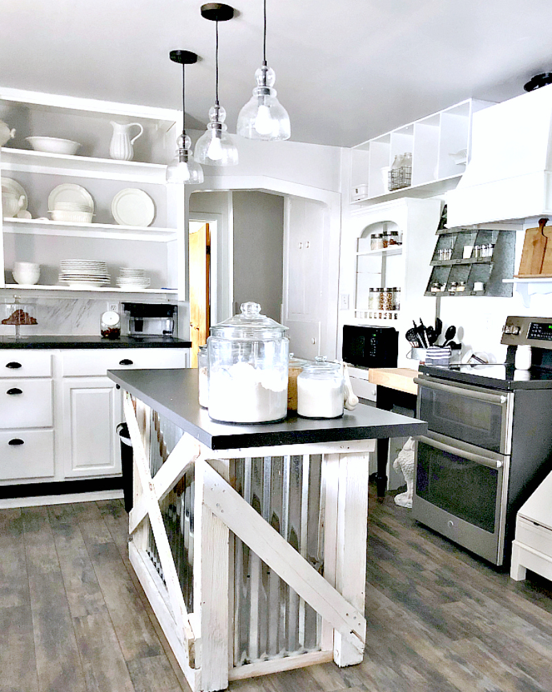 Industrial farmhouse white kitchen with corrugated metal island by One More Time, featured on Funky Junk Interiors