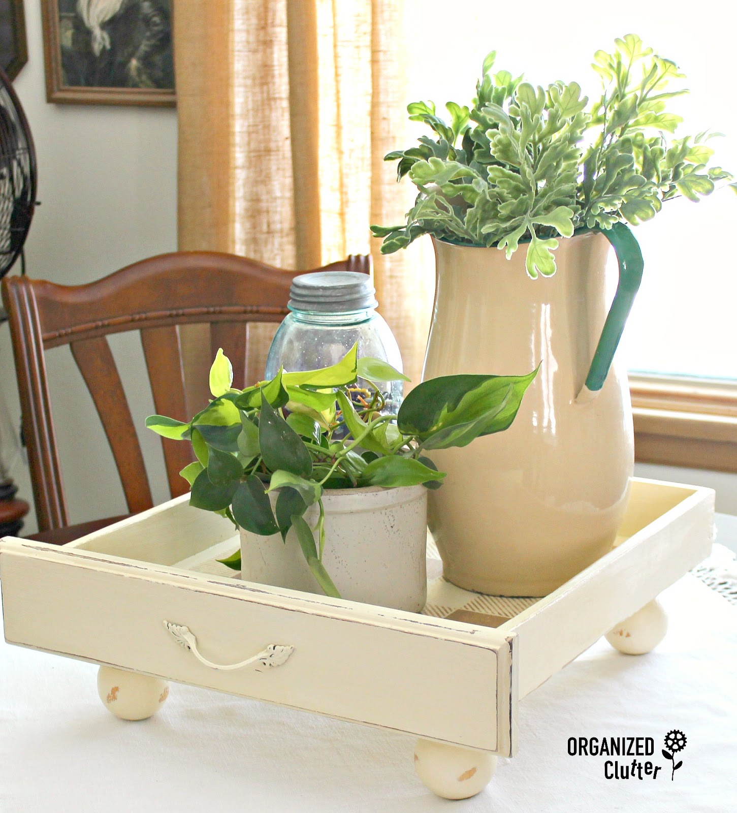 Repurposed drawer turned raised plant tray by Organized Clutter, featured on Funky Junk Interiors