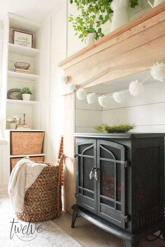 DIY Faux farmhouse fireplace and mantel by Twelve On Main, featured on Funky Junk Interiors