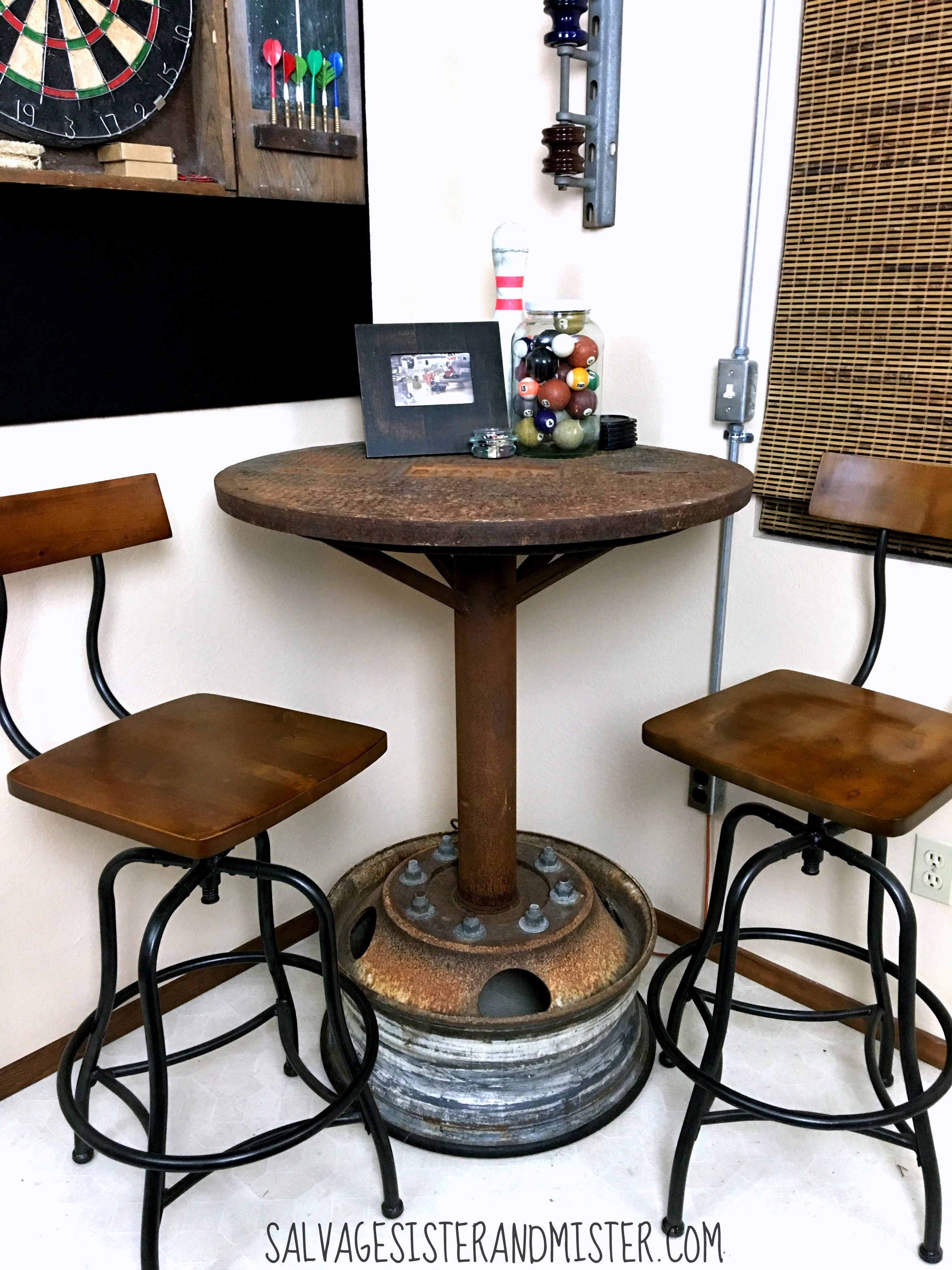 Industrial wheel bar table by Salvage Sister And Mister, featured on Funky Junk Interiors