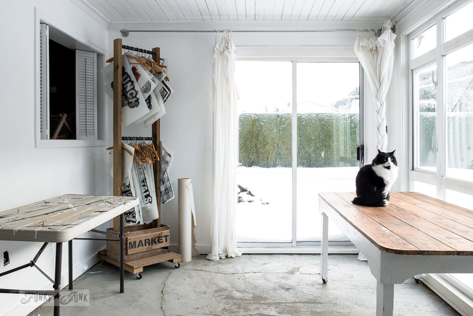White well lit indoor photo studio workspace with a farmtable and stencil trolley | funkyjunkinteriors.net