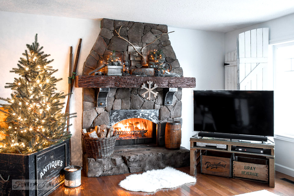 Winter lit tree and snowy fireplace mantel. Part of Rustic winter decorating with black, white and wood. Full tour on funkyjunkinteriors.net