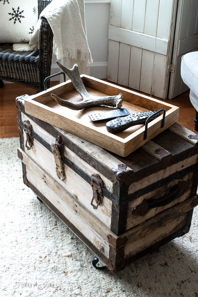 Rustic wooden tray on top of a vintage trunk coffee table \ Part of winter decorating with black, wood and white. Full tour on funkyjunkinteriors.net