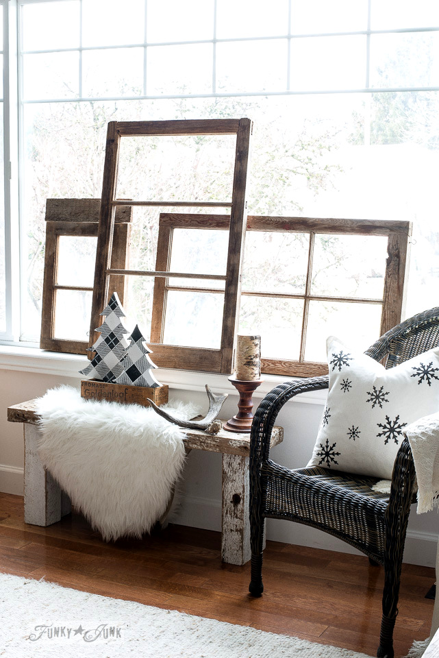 Wooden vintage windows, buffalo checked winter trees and a snowflake pillow in a winter living room. Rustic winter decorating with black, white and wood. Full tour on funkyjunkinteriors.net