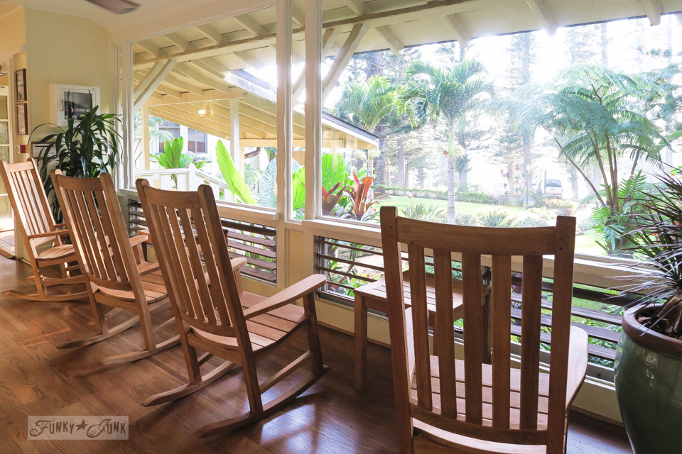 The interior rocking chair filled hallway of Hotel Lana'i, a gorgeous plantation styled hotel surrounded by tall pine trees in Lana'i Hawaii