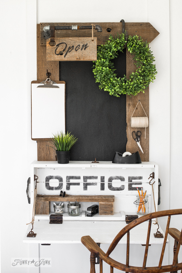 Learn how to make this lidded crate into a compact rustic office desk along with a reclaimed wood framed chalkboard and industrial pipe Open sign. With Funky Junk's Old Sign Stencils. #funkyjunkinteriors #oldsignstencils #fusionmineralpaint #chalkboard #office #furniture #diy #reclaimedwood #farmhouse