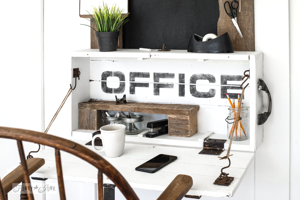 Not much room for a desktop? Perhaps this little lidded crate office desk with pipe Open sign complete with framed bulletin board will fit! Great for tight spaces. Signs made with Funky Junk's Old Sign Stencils and Fusion Mineral Paint. #funkyjunkinteriors #oldsignstencils #fusionmineralpaint #office #chalkboard #rustic