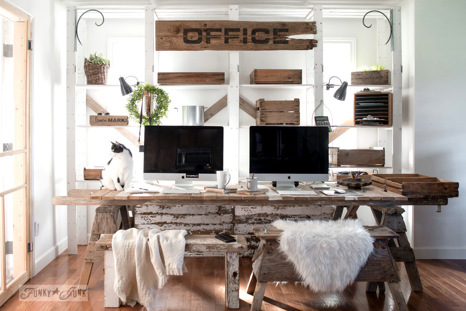 Rustic sawhorse and pallet wood blog office in a dining room.