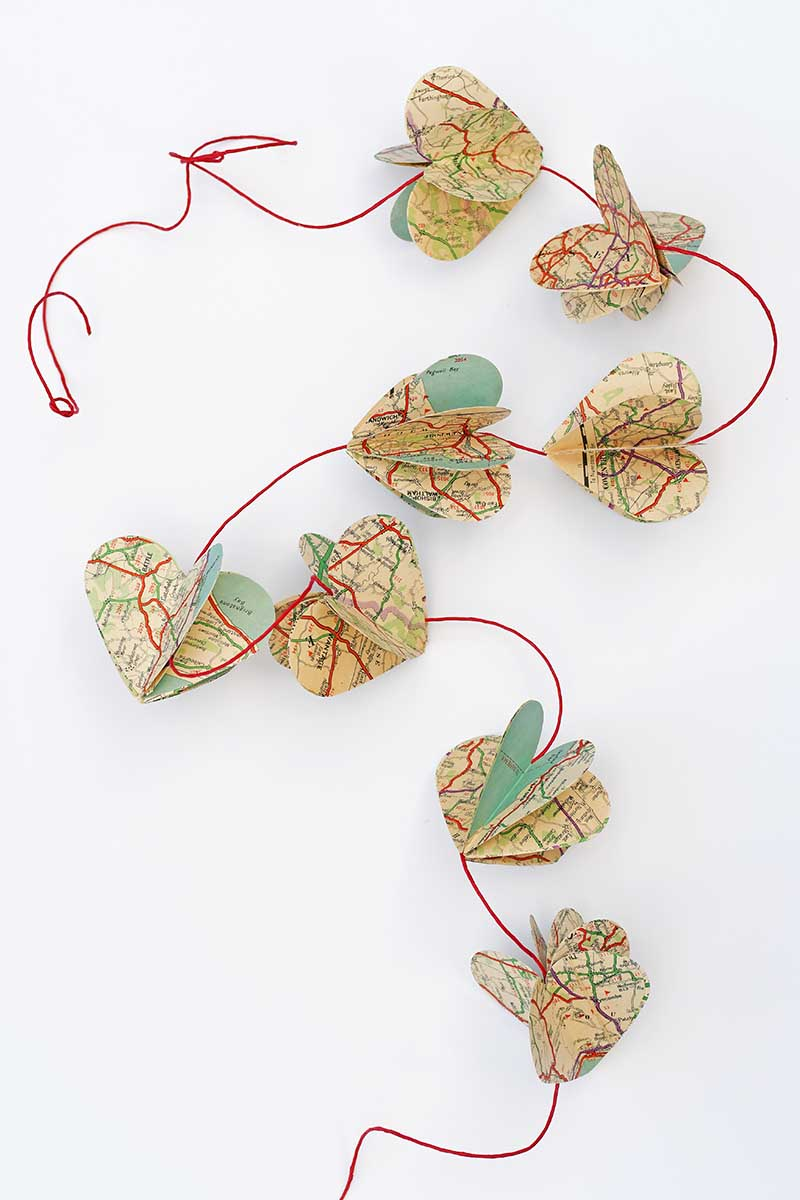 Vintage map heart garland by Pillar Box Blue, featured on Funky Junk Interiors