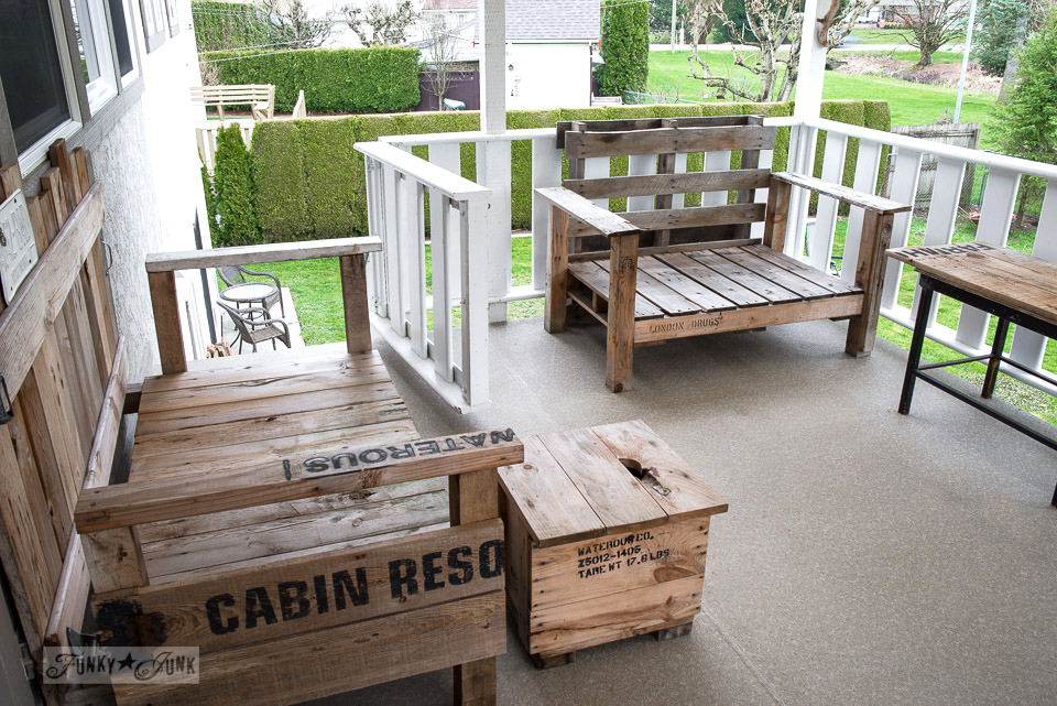Cleaned pallet wood furniture on a back patio, part of how to spring clean the outdoors through pressure washing with tips