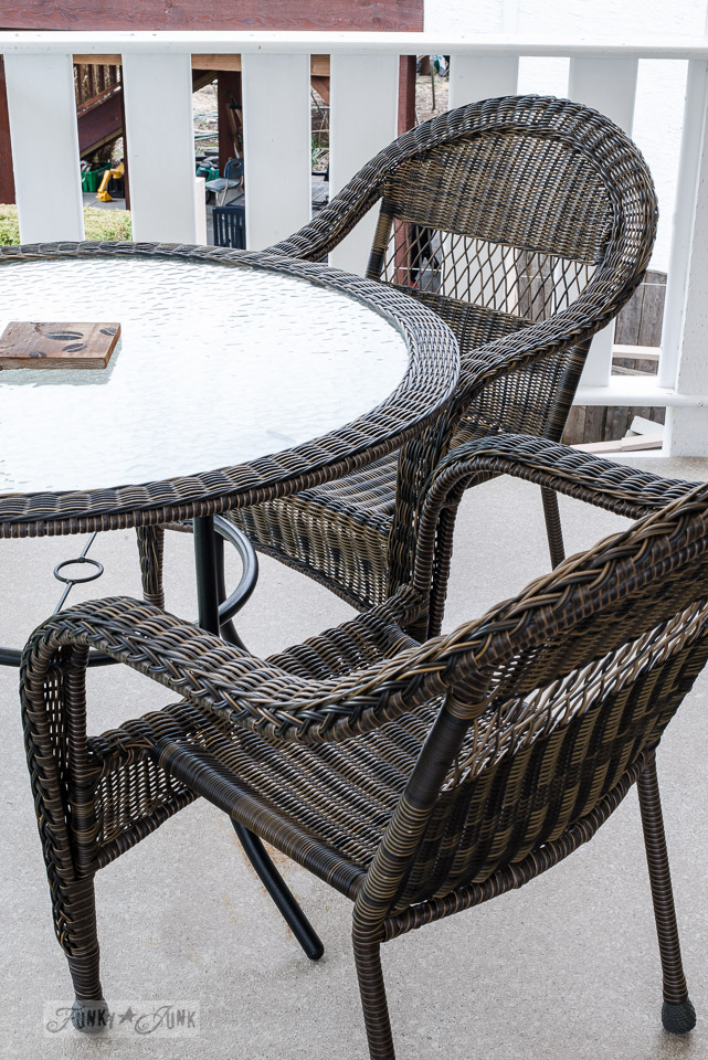 Newly cleaned wicker resin outdoor furniture sitting on a freshly pressure washed patio, part of How to spring clean the outdoors with pressure washing tips