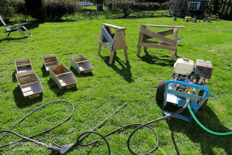 Everything out on the lawn to prepare for spring cleaning pressure washing