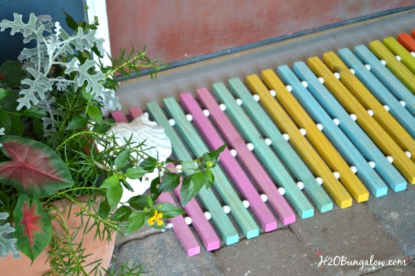 DIY wood doormat in spring colours by H2O Bungalow, featured on Funky Junk Interiors