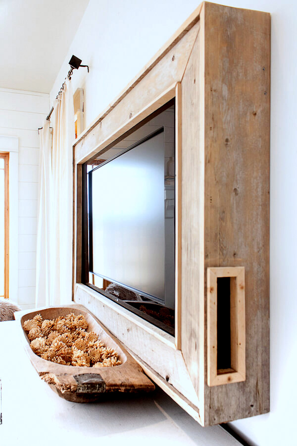 Rustic wood TV frame on a wall by Twelve On Main, featured on Funky Junk Interiors