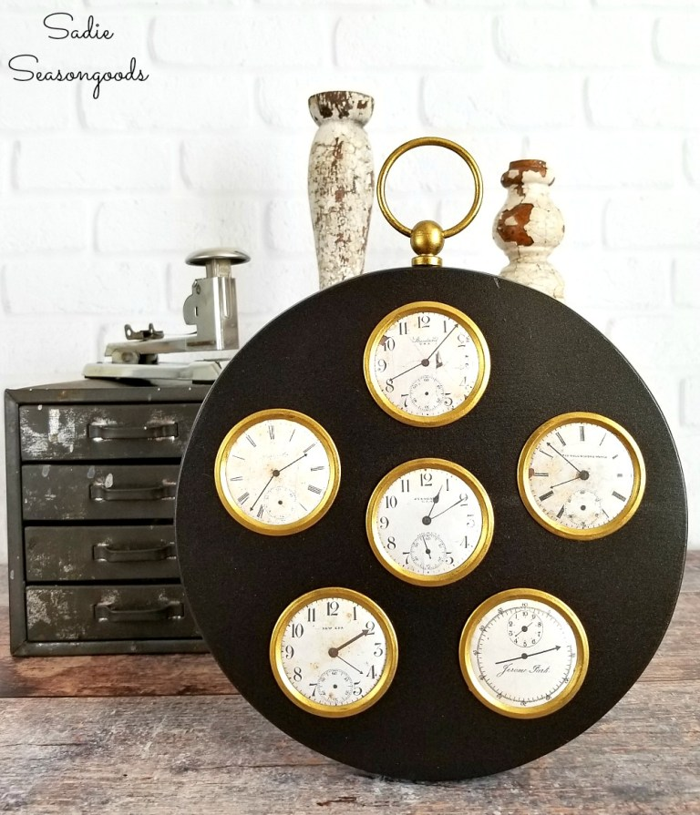Faux clocks in a picture frame by Sadie Seasongoods, featured on Funky Junk Interiors