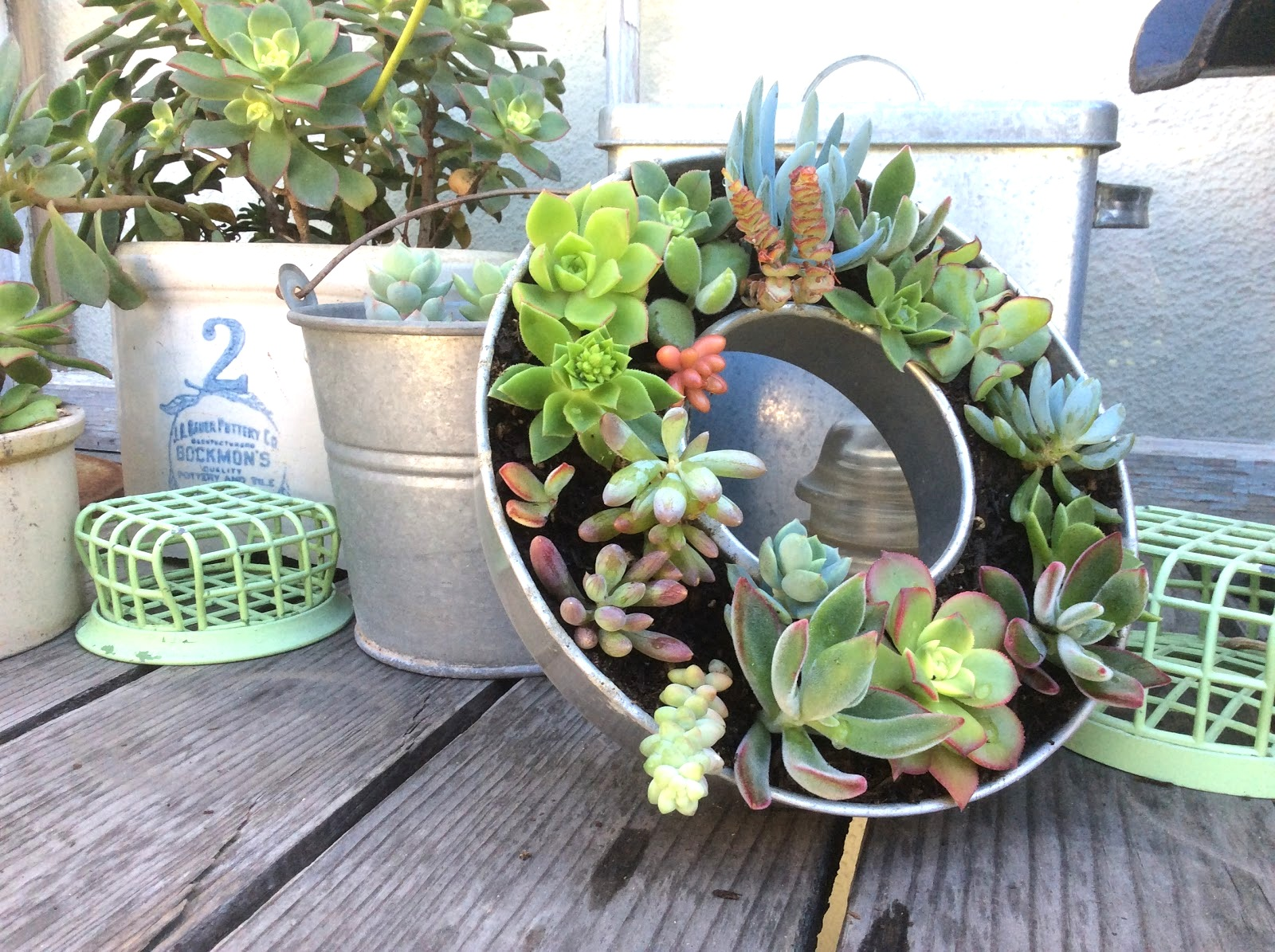 Kitchenware repurposed planters with a succulent wreath by Fresh Vintage Bliss, featured on Funky Junk Interiors