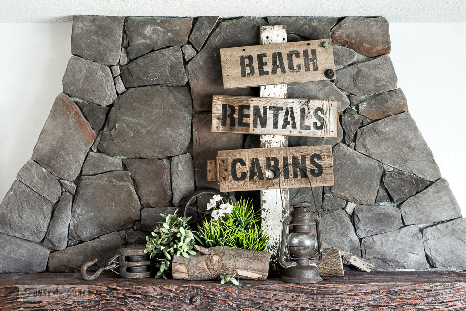 Rustic vacation directional signs on a post with Cabins, Rentals, Beach. Made with Funky Junk's Old Sign Stencils #oldsignstencils #funkyjunkinteriors #rustic #reclaimedwood #signs #stencils