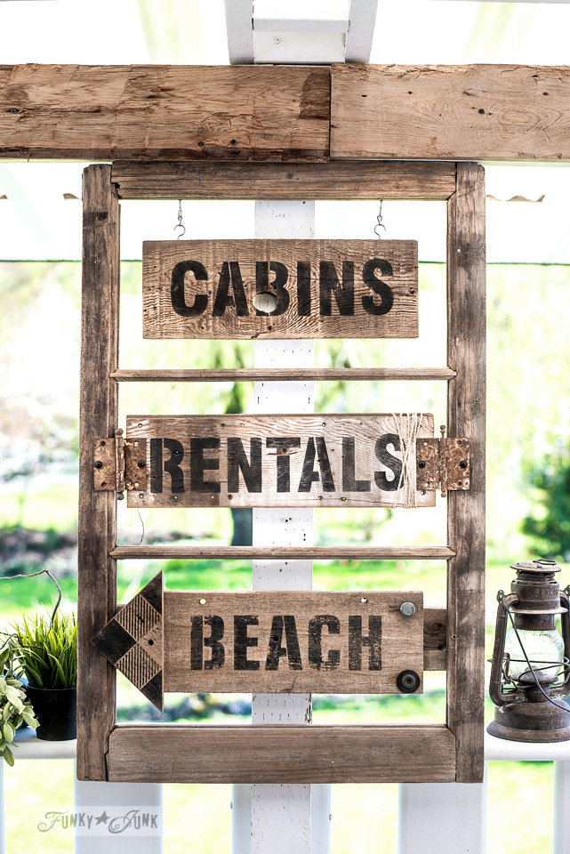 How to stencil a summer themed directional sign with an old window! Featuring Cabins, Rentals and Beach with Funky Junk's Old Sign Stencils. Click for full tutorial.