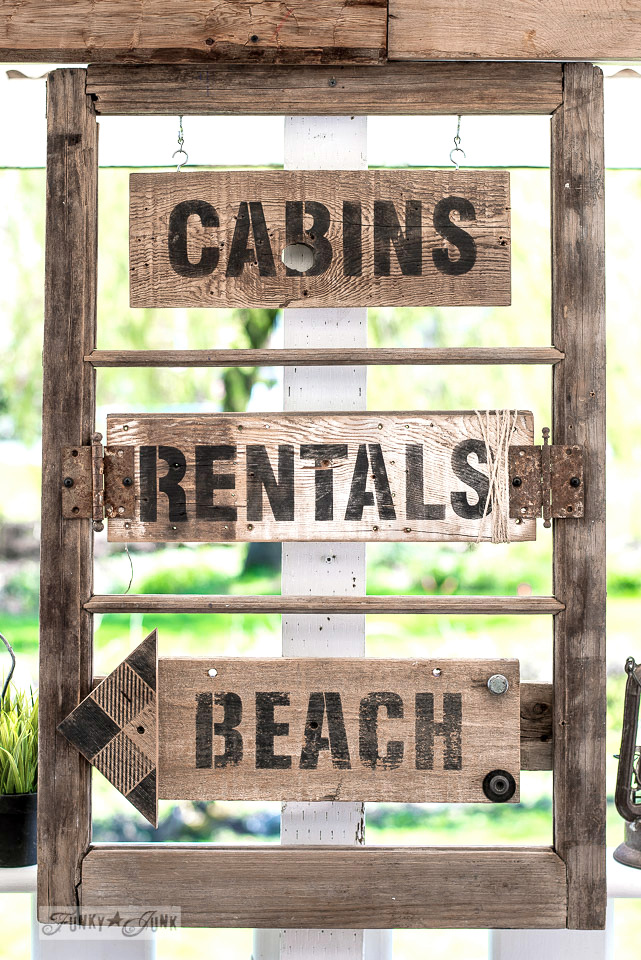 Learn how to make these charming rustic vacation directional signs in an old window with Cabins, Rentals, Beach. Made with Funky Junk's Old Sign Stencils Click to full tutorial! #oldsignstencils #funkyjunkinteriors #rustic #reclaimedwood #signs #stencils