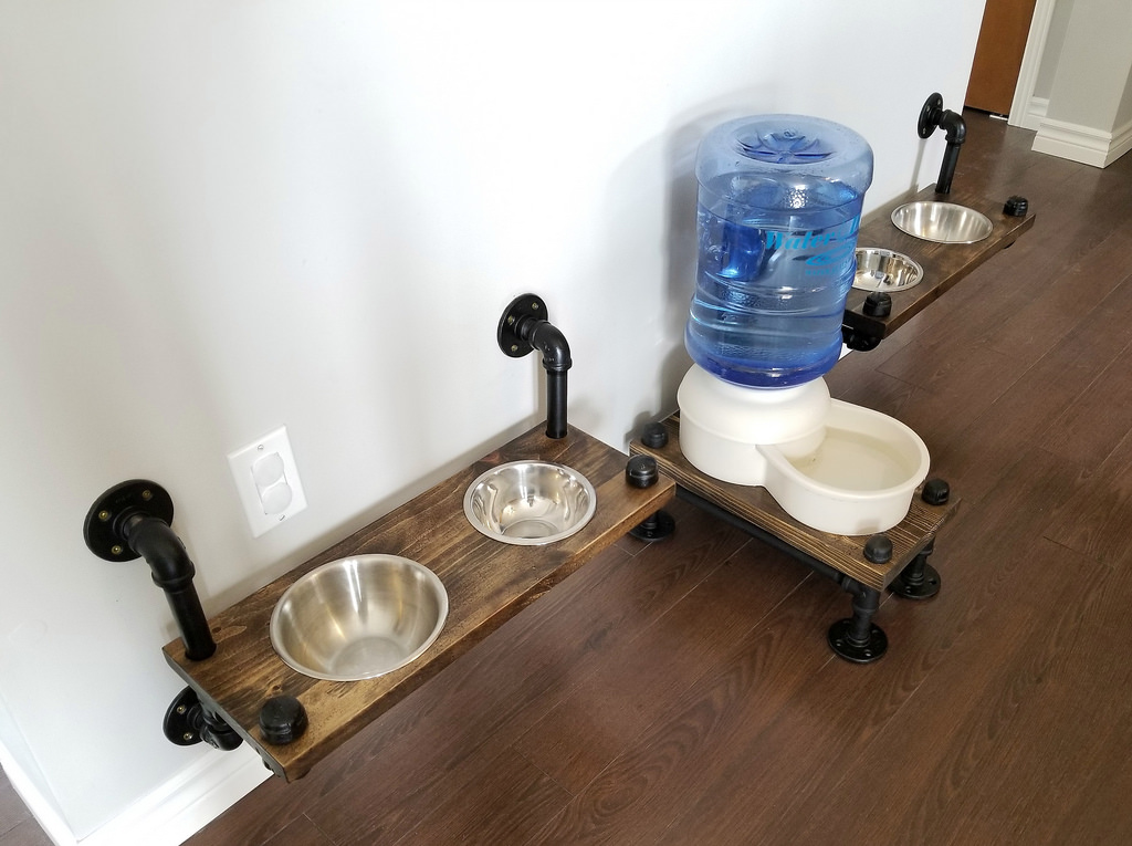 Industrial farmhouse pipe and wood pet feeding station by Turtles and Tails, featured on Funky Junk Interiors