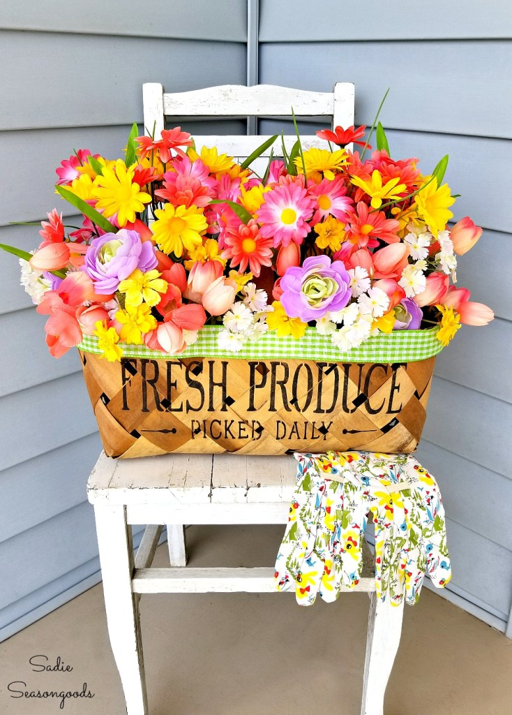 Spring flowers porch decor with a basket sign by Sadie Seasongoods, featured on Funky Junk Interiors