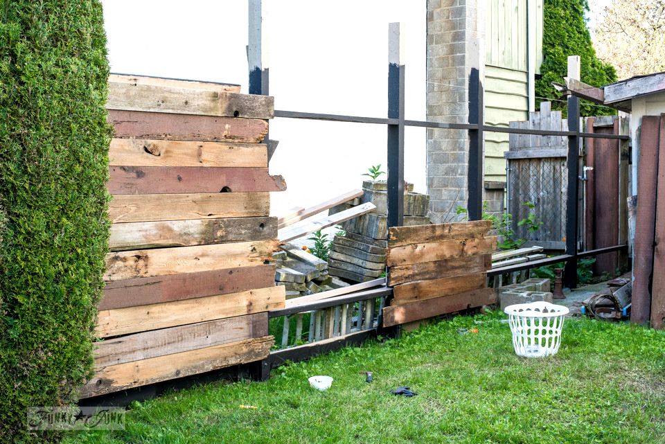 How to build a reclaimed wood backyard garden fence.