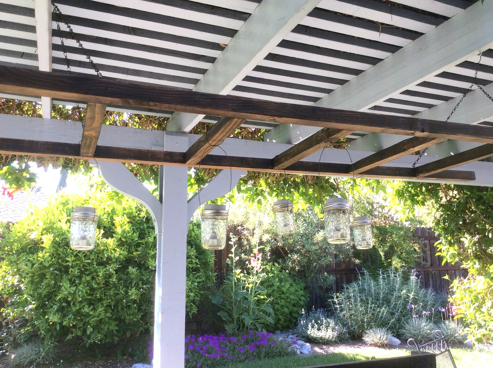 Solar panel patio lights on a ladder by Fresh Vintage by Lisa S, featured on Funky Junk Interiors
