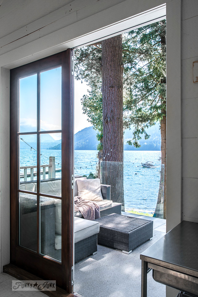 Lake view from inside a dreamy white shiplapped lake cottage at Cultus Lake, BC