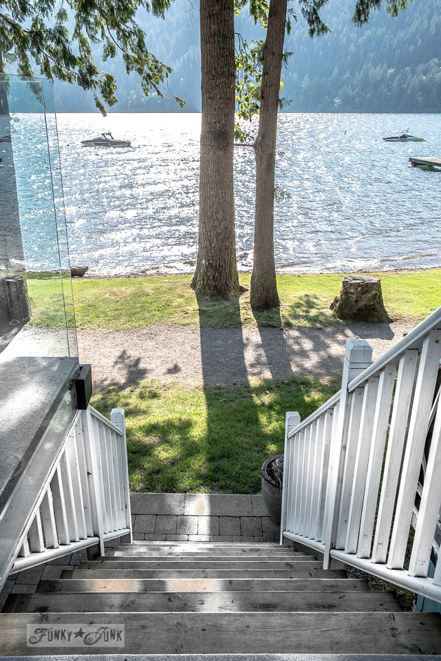 The deck stairs down to the lake - part of A dreamy white shiplapped cottage tour at Cultus Lake, BC