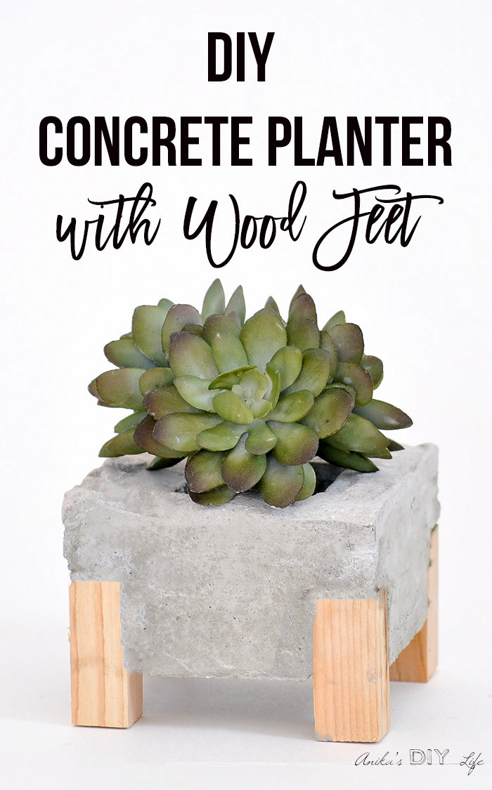 DIY concrete planter from a box with wood feet by Anika's DIY Life, featured on Funky Junk Interiors