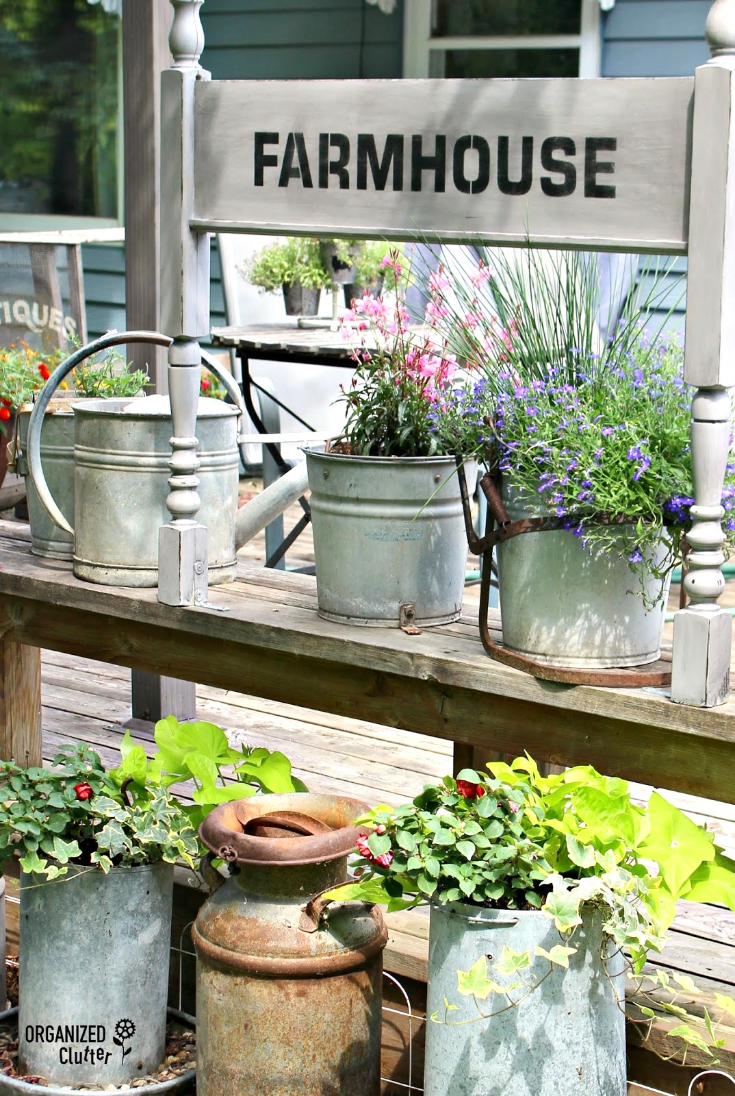 Footboard FARMHOUSE garden junk sign in a flowerbed by Organized Clutter, featured on Funky Junk Interiors
