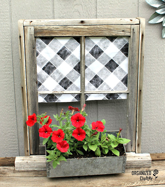 Window box garden art with Buffalo Check curtains by Organized Clutter, featured on Funky Junk Interiors