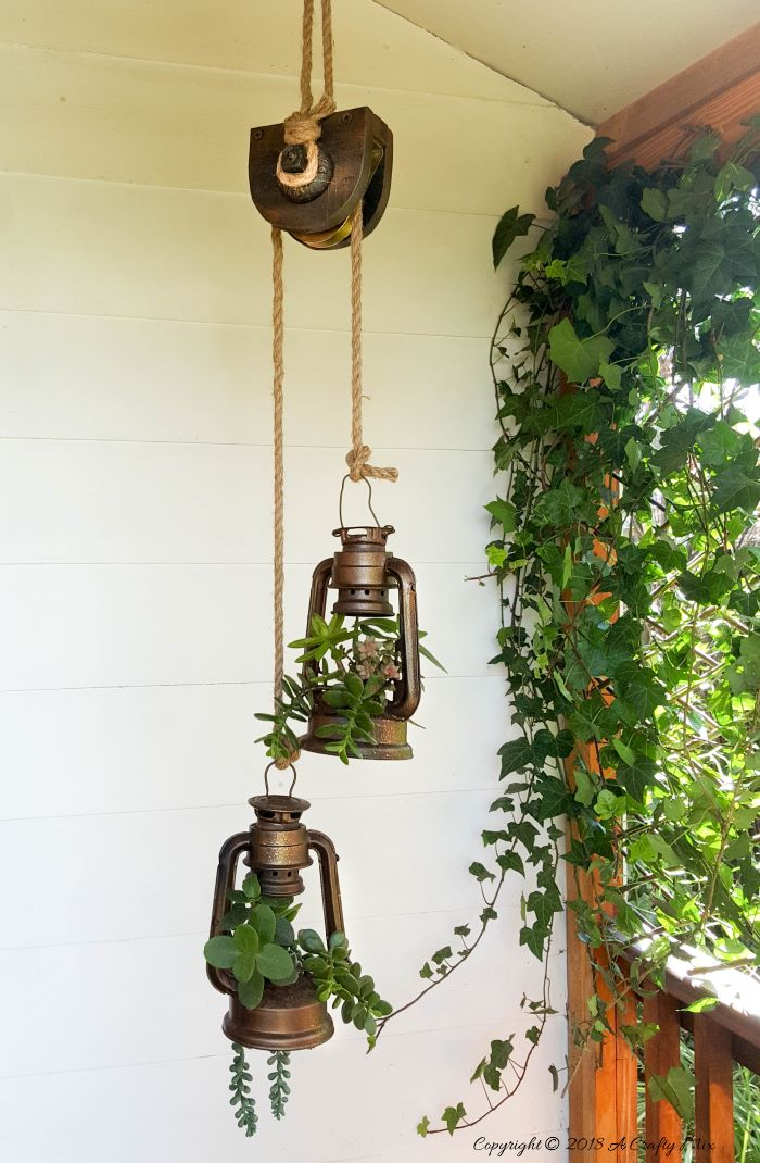 Lantern and pulley succulent planters by A Crafty Mix, featured on Funky Junk Interiors