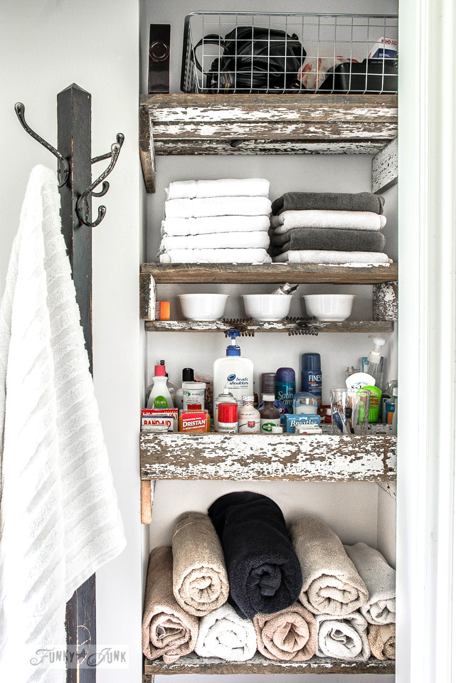 Reclaimed wood shelves in a bathroom by Funky Junk Interiors