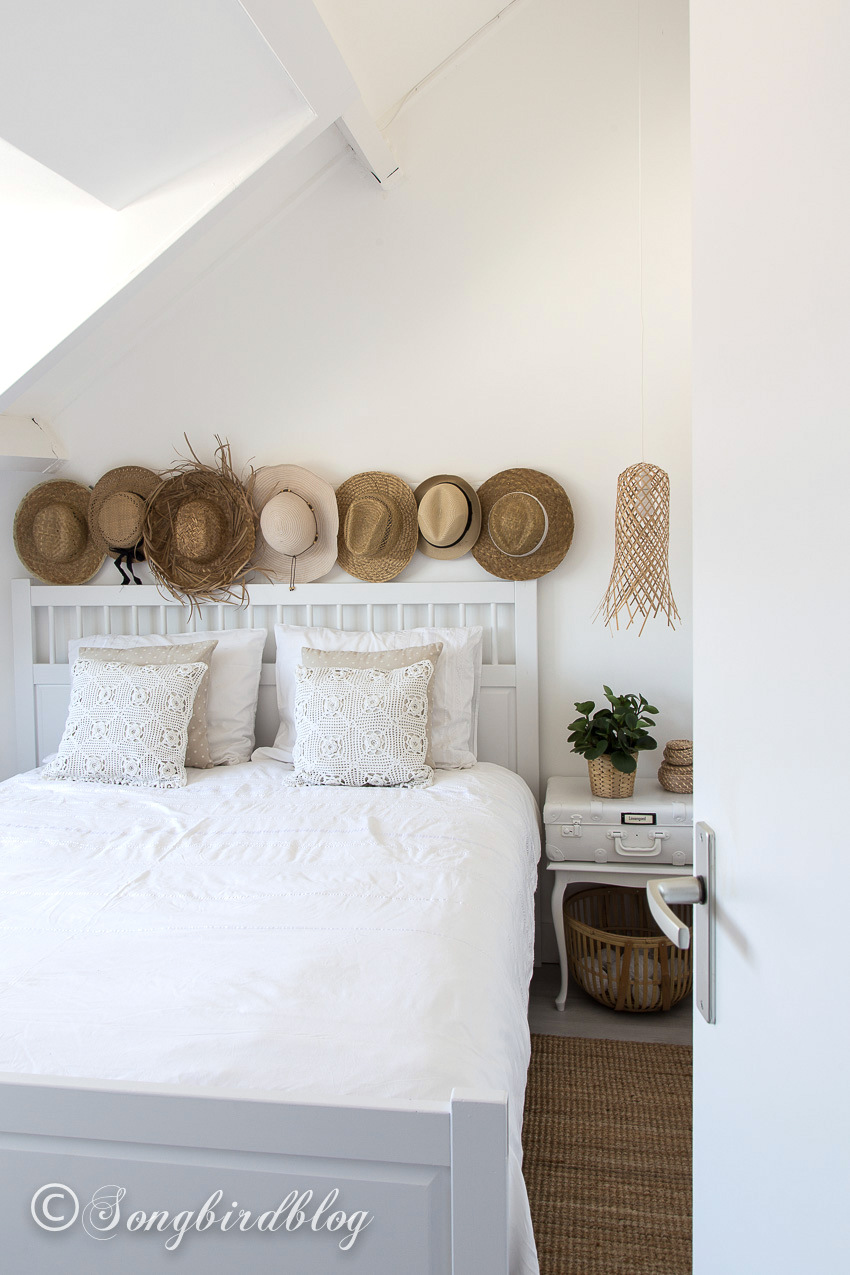 Straw hat boho bedroom by Songbird, featured on Funky Junk Interiors