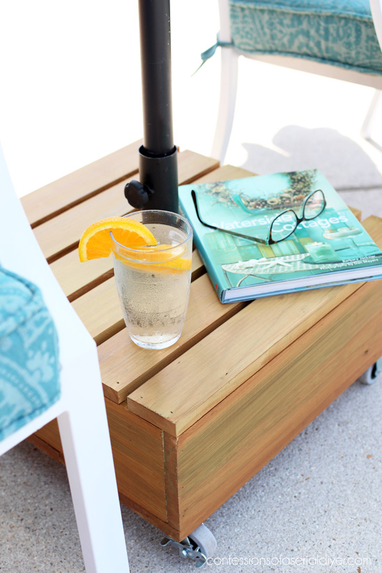 Outdoor rolling umbrella coffee table base by Confessions of a Serial DIYer, featured on Funky Junk Interiors
