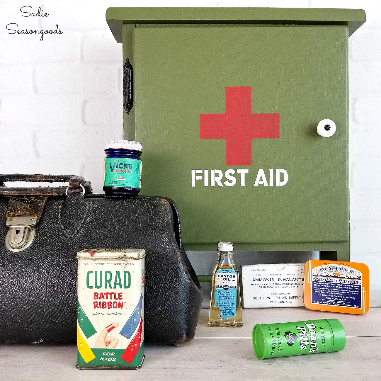 Vintage inspired military stenciled first aid kit by Sadie Seasongoods, featured on Funky Junk Interiors