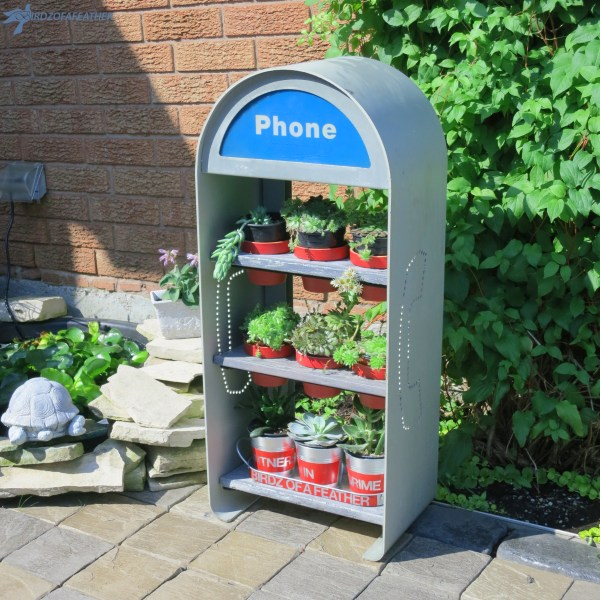 Phone booth plant shelves by Birdz of a Feather, featured on Funky Junk Interiors