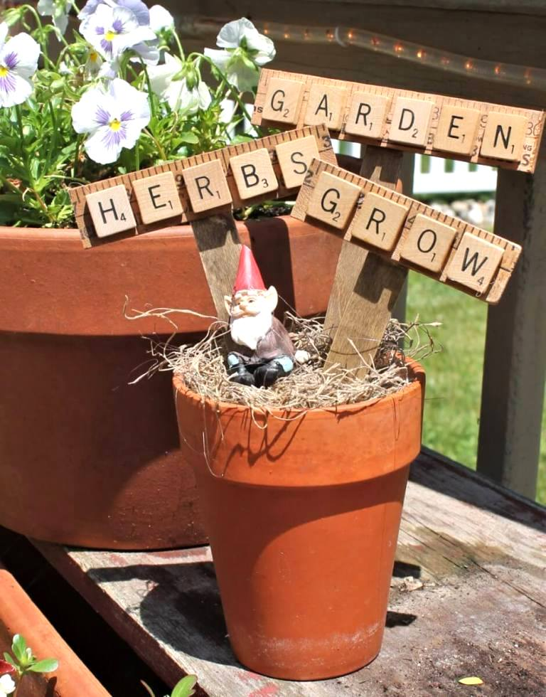 Scrabble tile and yardstick garden markers by Adirondack Girl At Heart, featured on Funky Junk Interiors