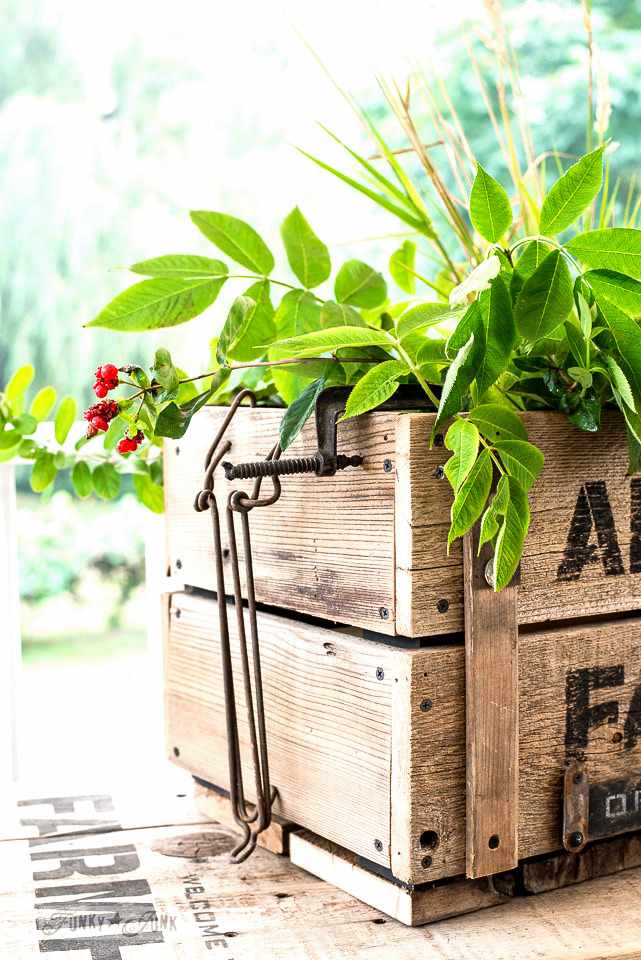 Adding rusty junk to a DIY rustic Apple Farm crate for fall, made with Funky Junk's Old Sign Stencils