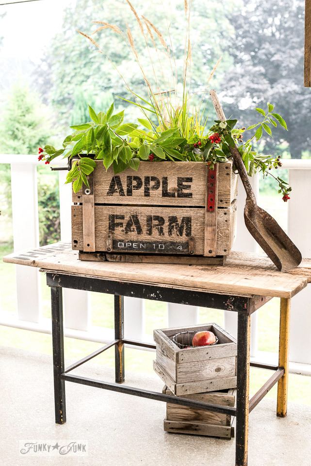 Build a DIY rustic Apple Farm crate for fall! Here it's staged with grass and tree branches for an apple farm look! Sign made with Funky Junk's Old Sign Stencils #oldsignstencils #funkyjunkinteriors