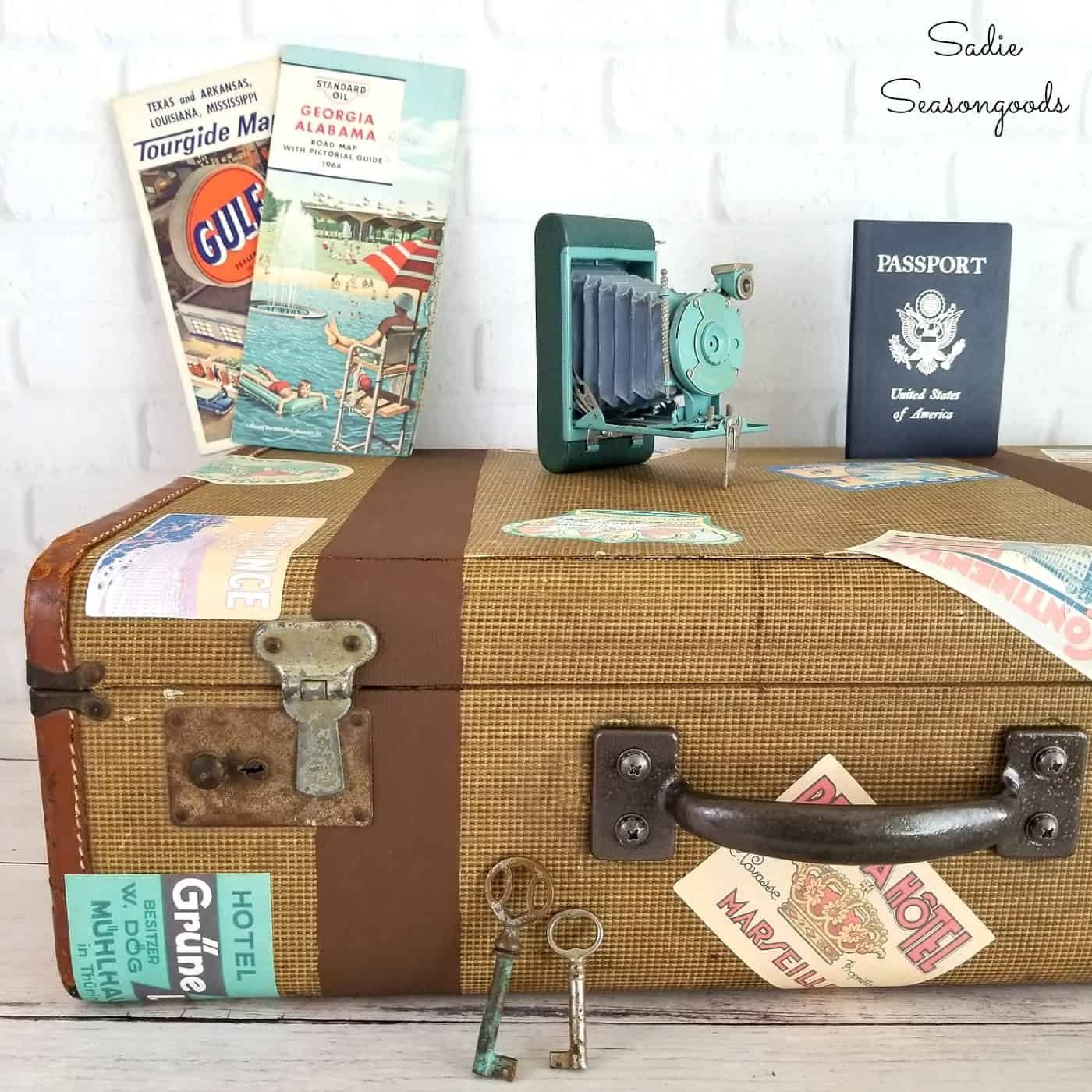 DIY vintage luggage with travel stickers by Sadie Seasongoods, featured on Funky Junk Interiors