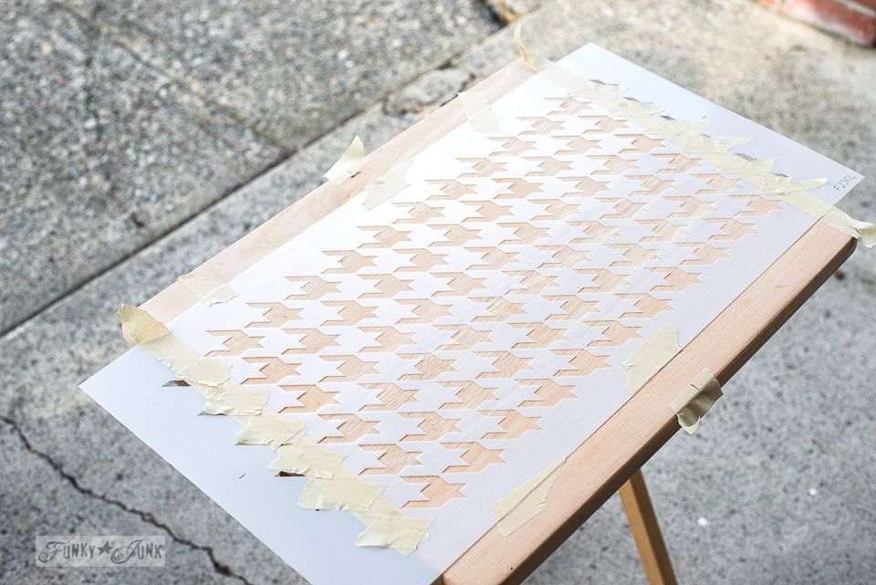 Positioning the Houndstooth stencil on a TV tray for a makeover - Funky Junk's Old Sign Stencils