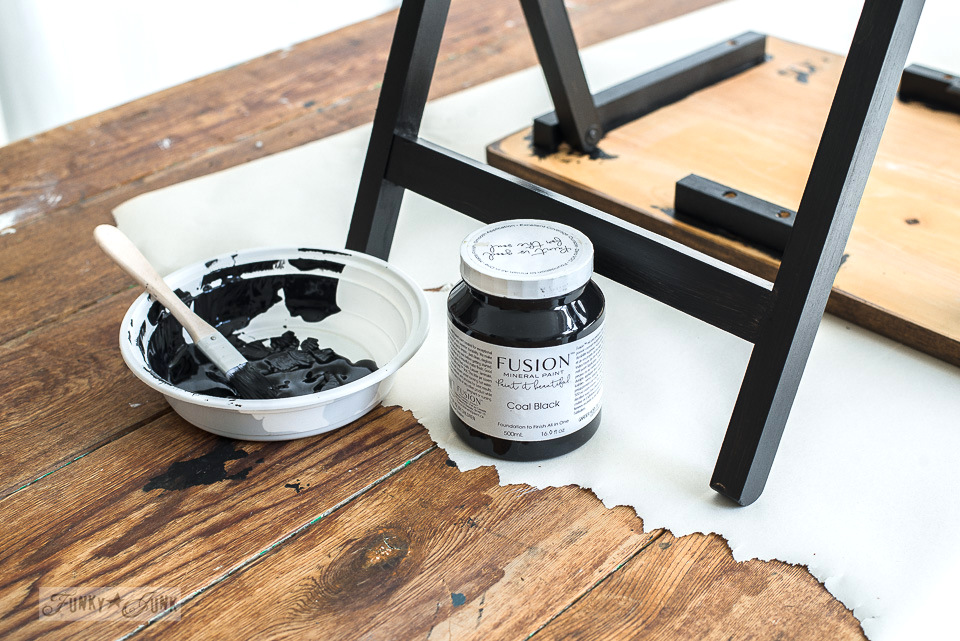 Painting the legs of a TV tray with Fusion Mineral Paint's Coal Black