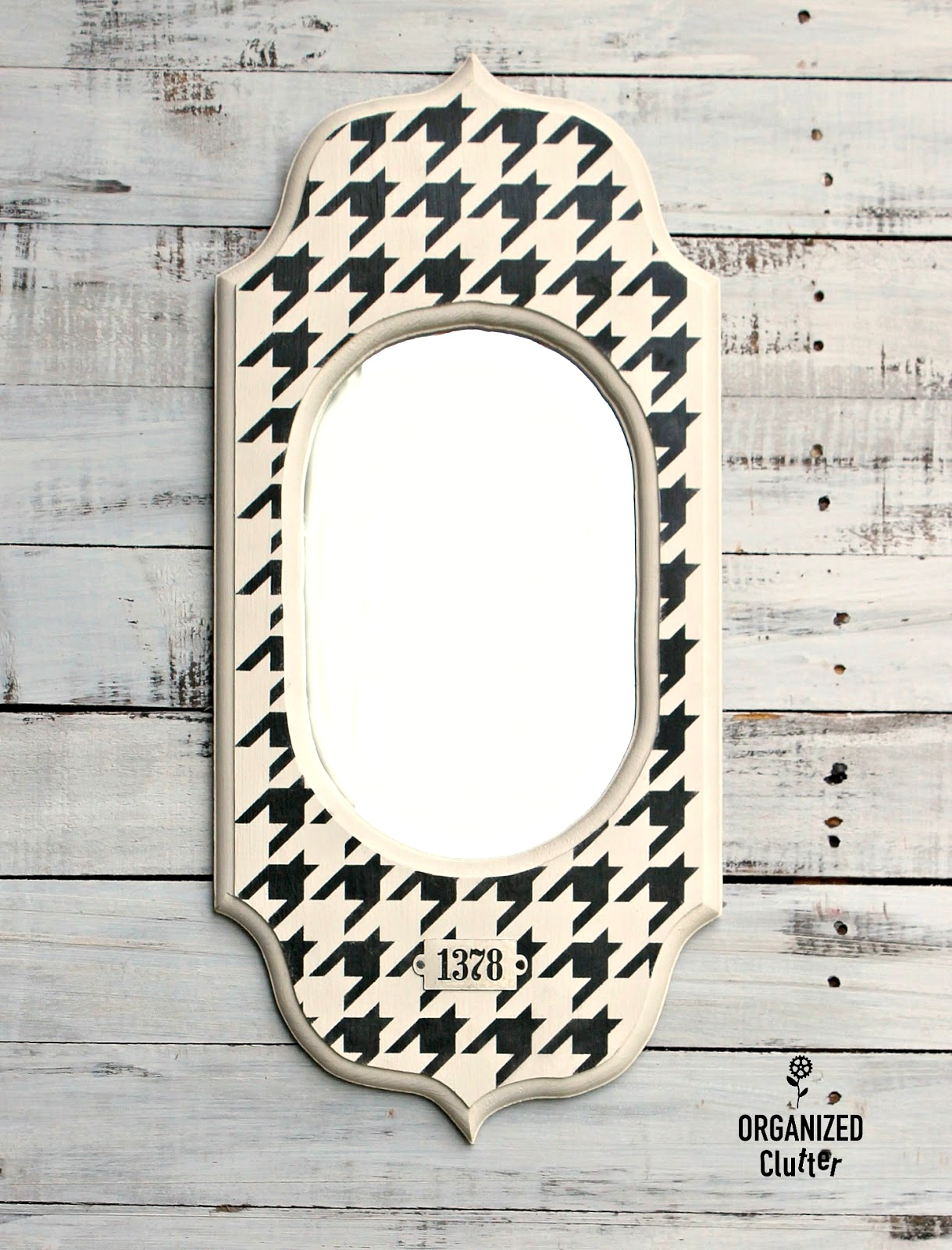 Houndstooth revamped thrift store mirror frame by Organized Clutter, featured on Funky Junk Interiors