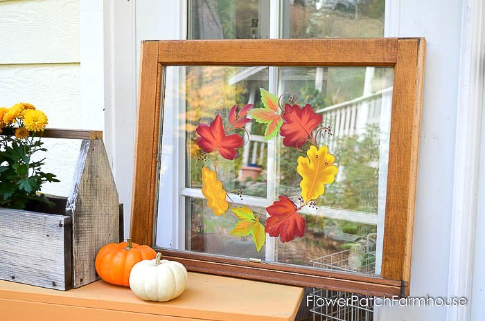 Hand painted autumn leaves on a vintage window by Flower Patch Farmhouse, featured on Funky Junk Interiors