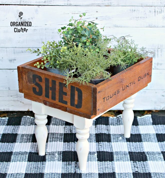 Stenciled raised crate planter on stool legs by Organized Clutter, featured on Funky Junk Interiors