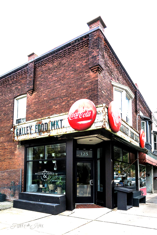 Historic brick Galley Food Market in Roncesvalles, Toronto with a vintage coke sign, part of a trip to Toronto in the fall.